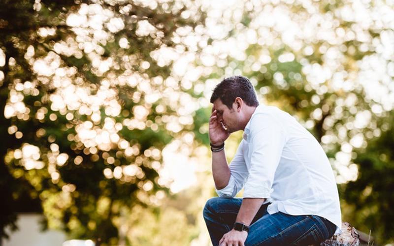 a man dealing with work stress