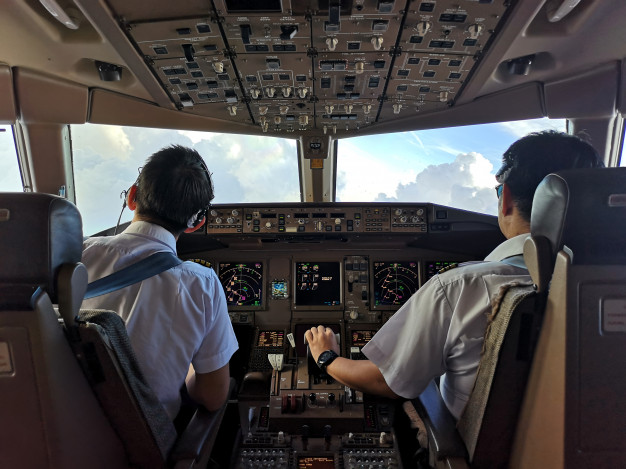 two pilots working inside the airplane